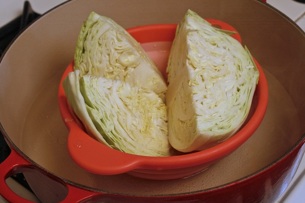 Cabbage in a steam basket in a dutch oven