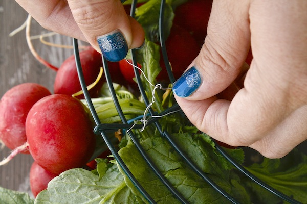 twist wire to tie radishes to wreath