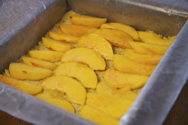 Lay peach wedges on maseca mixture