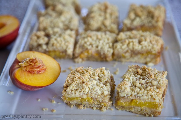 fresh peach crumble bars made with Maseca flour as the base