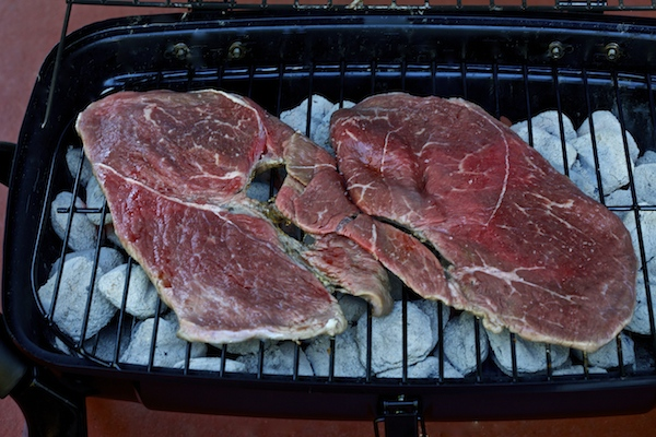 place meat on grill