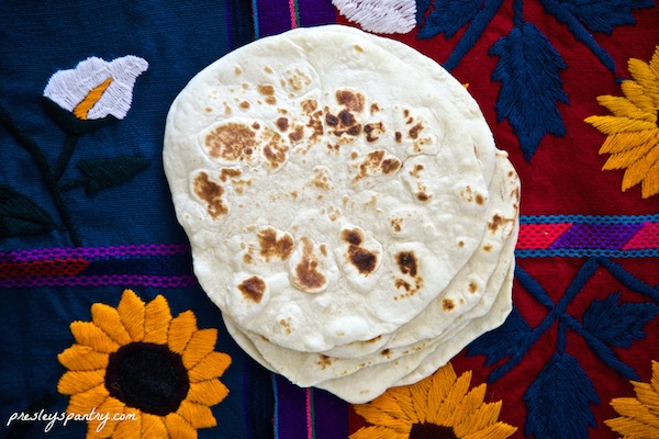 Stack of homemade flour tortillas #WMTMoms