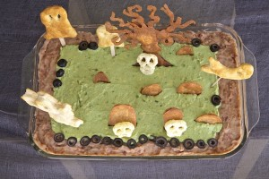 Over head view of Halloween graveyard bean dip