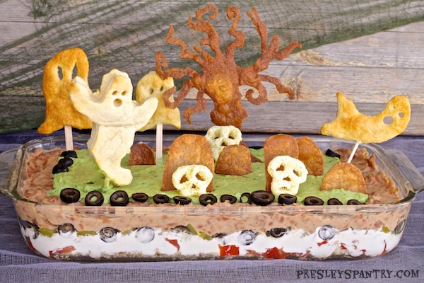 A Halloween graveyard bean dip. This dip makes for a great centerpiece until your ghostly guests are ready to eat.