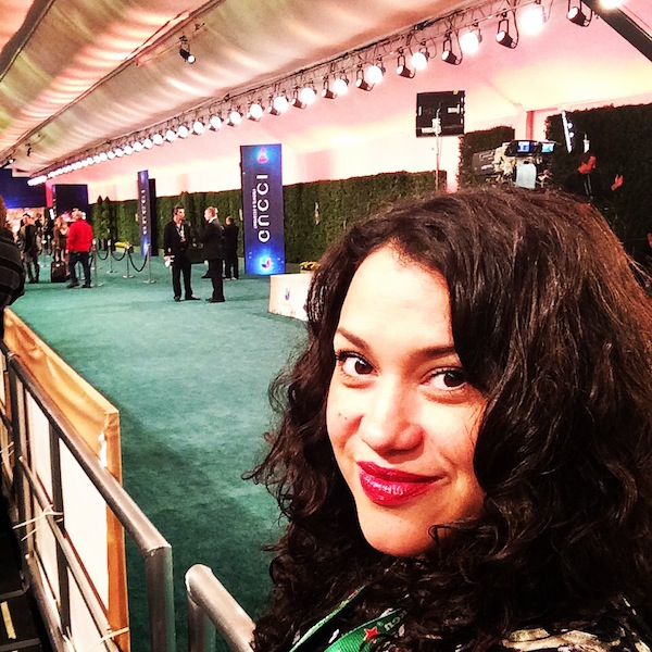 Nicole Presley on the green carpet on behalf of Walmart waiting to speak to the stars of the Latin grammys about food