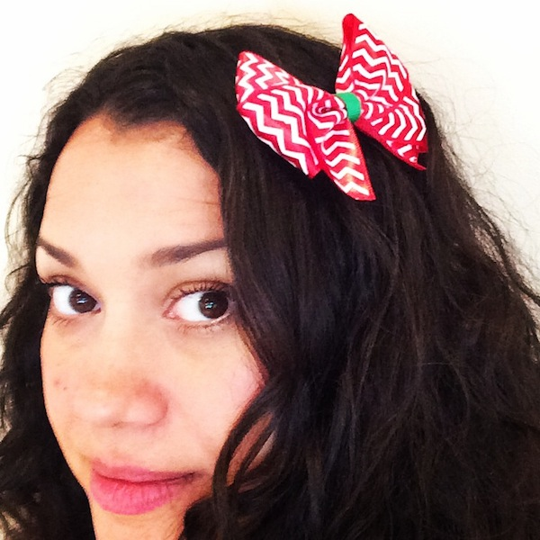 Nicole Presley wearing a holiday bow tie hair clip.