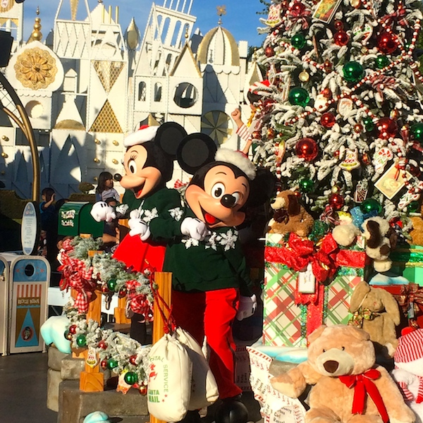 Mickey and Minnie at the head of A Christmas Fantasy Parade