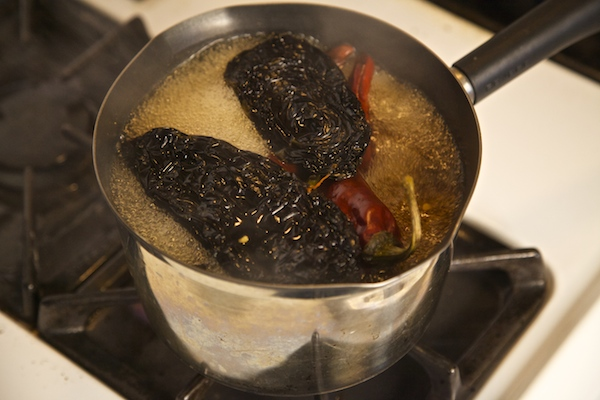 Ancho, new mexico and california chiles boiling to soften
