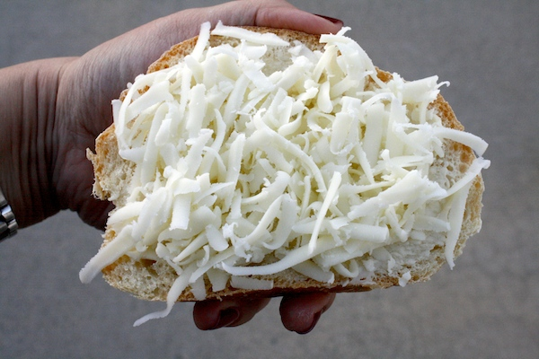Grated Cacique Oaxaca cheese on bread