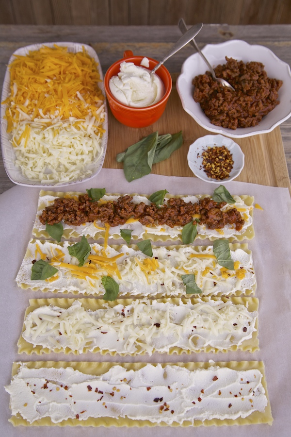 All noodles laying flat, and gradually filled with the ingredients needed to make manwich lasagna rolls. get the ingredients at Walmart.