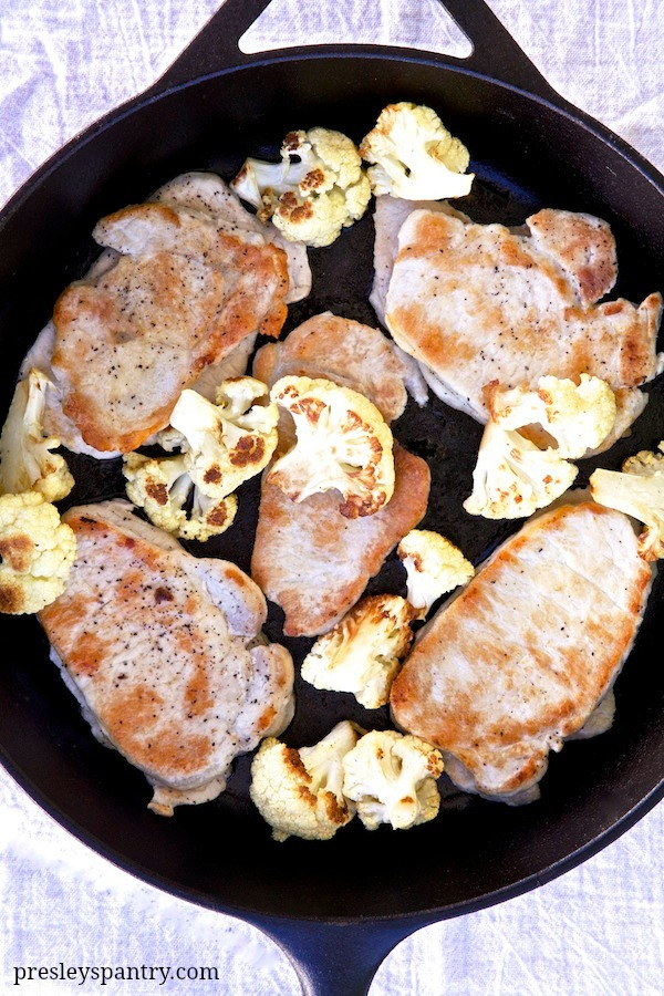 One skillet pork chops and cauliflower make for an easy dinner