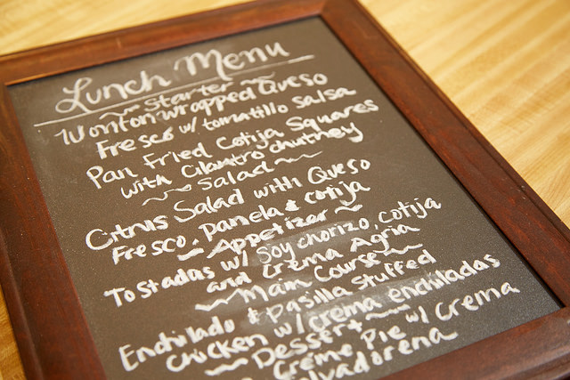 Cacique lunch menu written on a chalkboard at the immersion event.