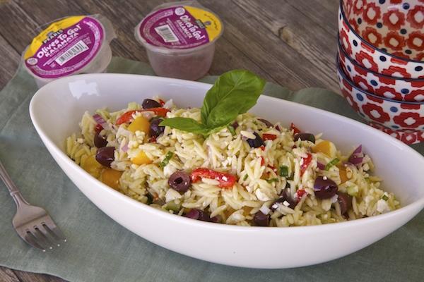 Olive orzo salad made with kalamata pearl olives.