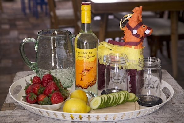 All the ingredients needed for Sangria refresco using Yellow Tail Sangria Blanco.