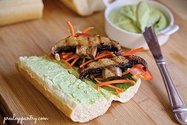 assembling a creamy pesto grilled mushroom sandwich