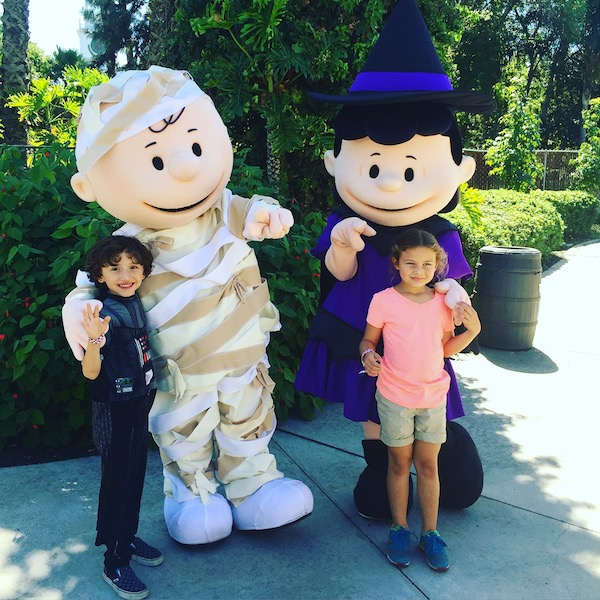 Charlie Brown and Lucy dressed in costume for Halloween At Knott's Spooky Farm