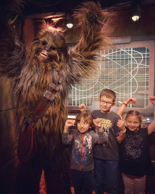 The kids meeting Chewbacca at Star Wars Launch Bay