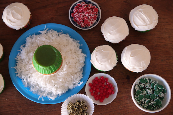 Dip your white cupcake in coconut shreds for a more festive looking ornament cupcake