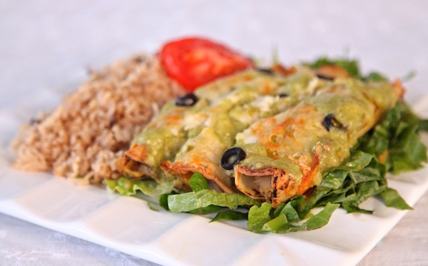 potato enchiladas topped in 4 queso blend and spicy tomatillo sauce