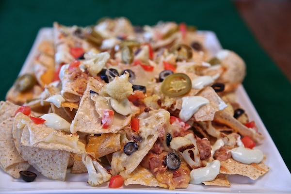 Cauliflower nachos for the big game. I got all my ingredients at walmart.