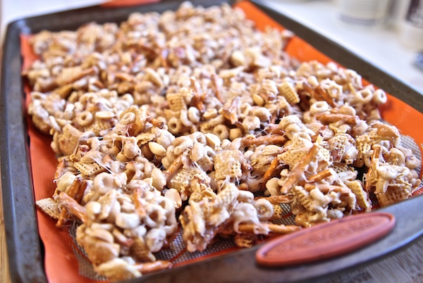 Crack candy clusters spread out on a cookie sheet.