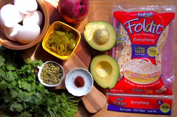 Ingredients for spicy egg salad wrapped in flatout flat bread.