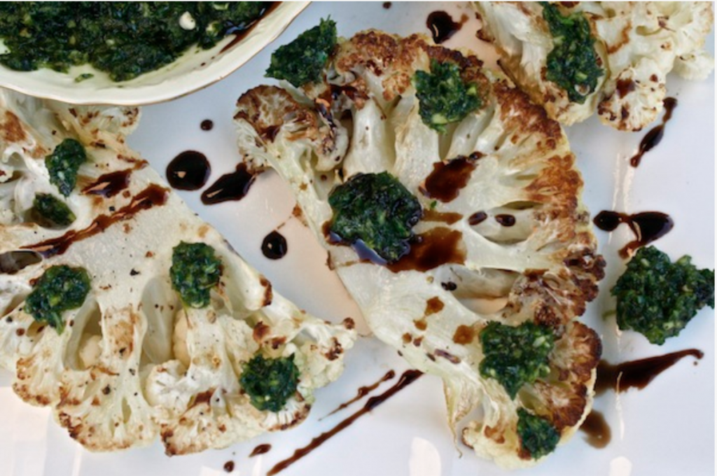 Roasted Cauliflower Steak Drizzled In Jalapeno Cilantro Chimichurri is a great vegan dish to make quickly