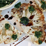 Roasted Cauliflower Steak Drizzled In Jalapeno Cilantro Chimichurri