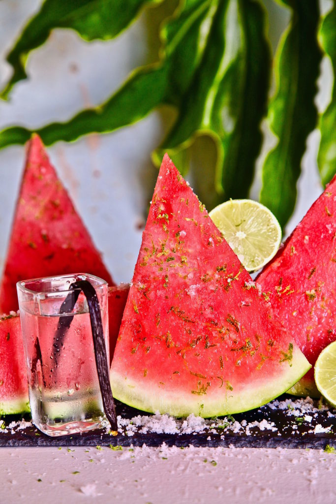 Vanilla vodka infused watermelon sprinkled in lime sugar is a great way to start a party.