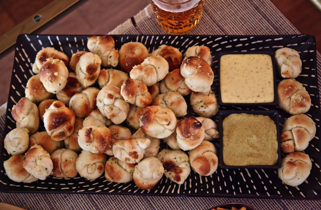 Garlic knots served with cheese and mustard from Cost Plus World Market
