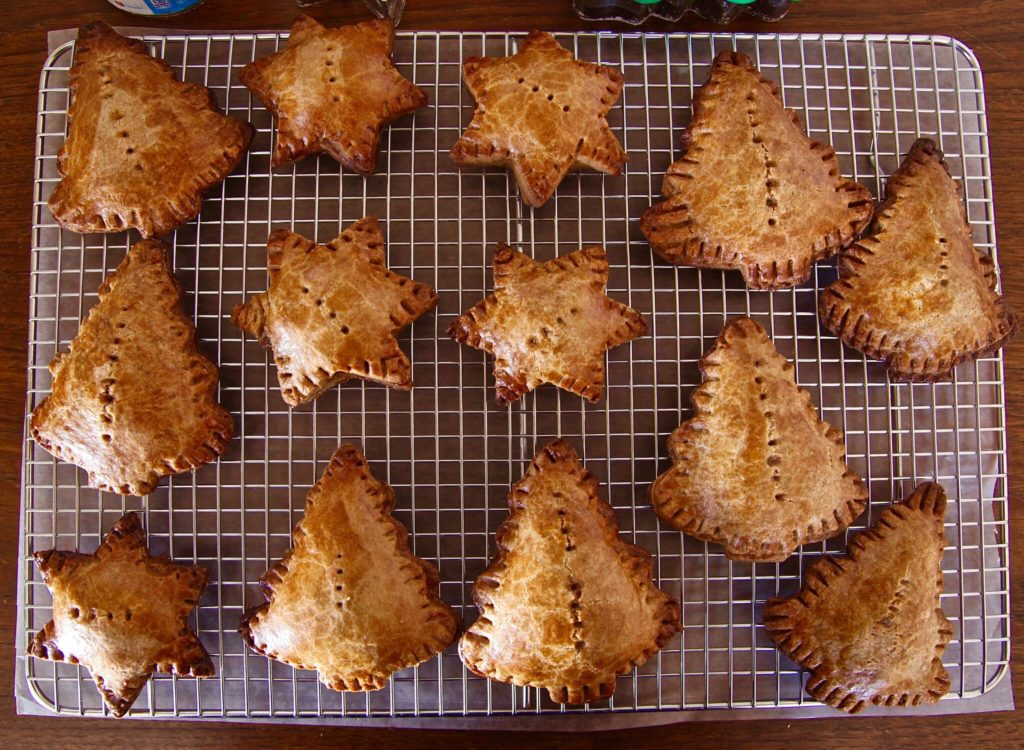 Baked Gingerbread Caramel Pear Empanadas fresh out of the oven.