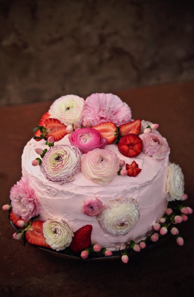 Strawberry ricotta cake decorated in ranunculus
