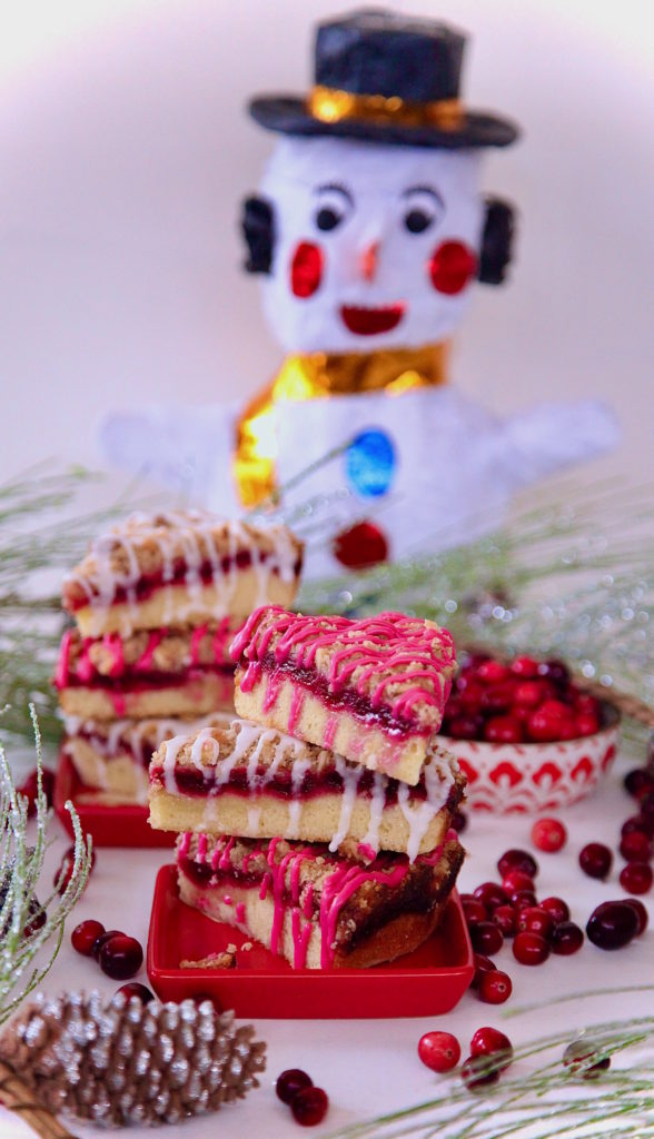 Snowman wanting to eat the cranberry coffeecake dressed in hibiscus glaze.