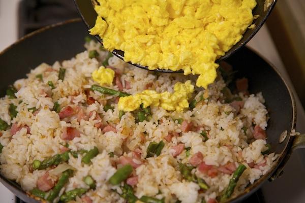Adding egg to fried rice