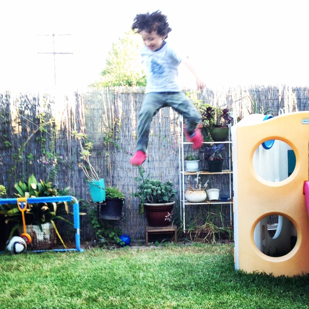 kid jumping off a slide