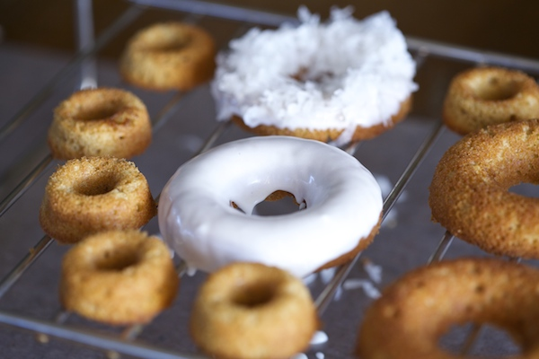 one donut iced, and one with coconut