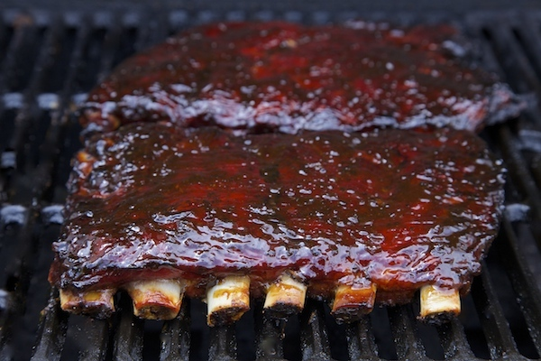 ribs on the grill freshly dressed in cherry chipotle Not Ketchup