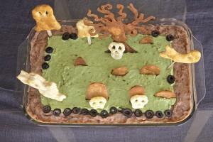 Over head view of Halloween graveyard bean dip