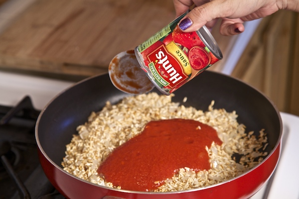 Making Mexican Rice with hunt's tomato sauce