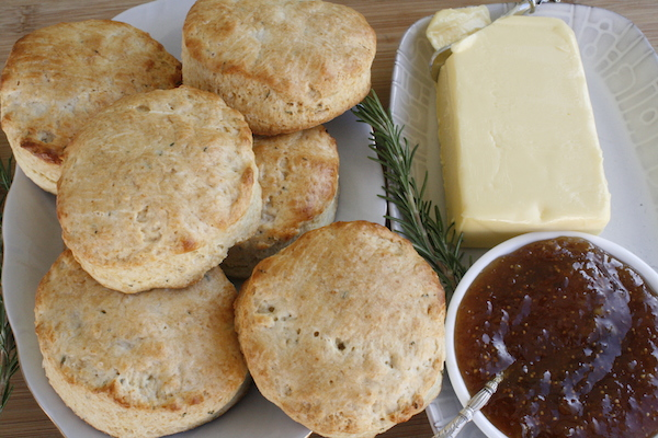 Rosemary buttermilk biscuits made from scratch and served with butter and fig orange jam
