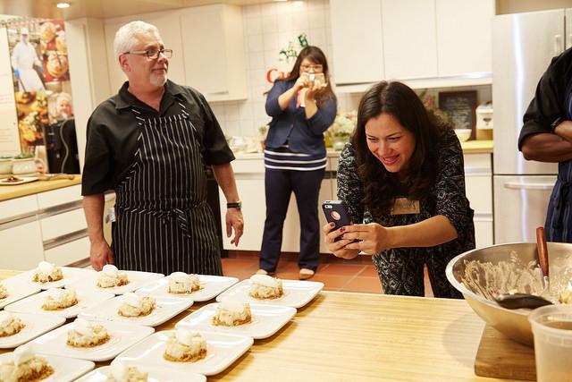 Nicole Presley taking a photo of Cacique Banana cream pies.