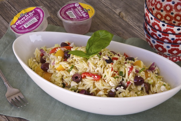 Olive orzo salad made with kalamata pearl olives.