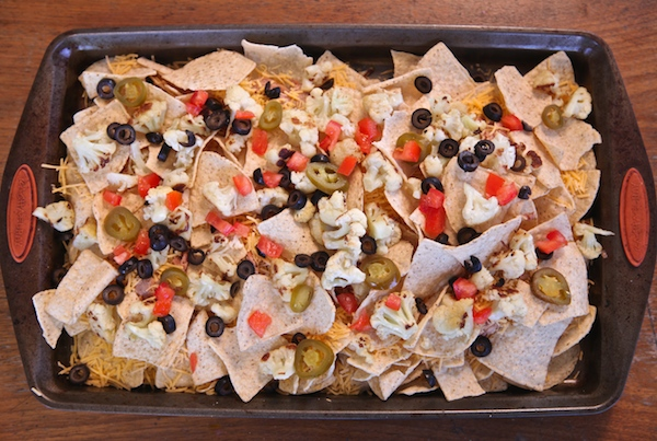 olives jalapeño and tomatoes top nachos