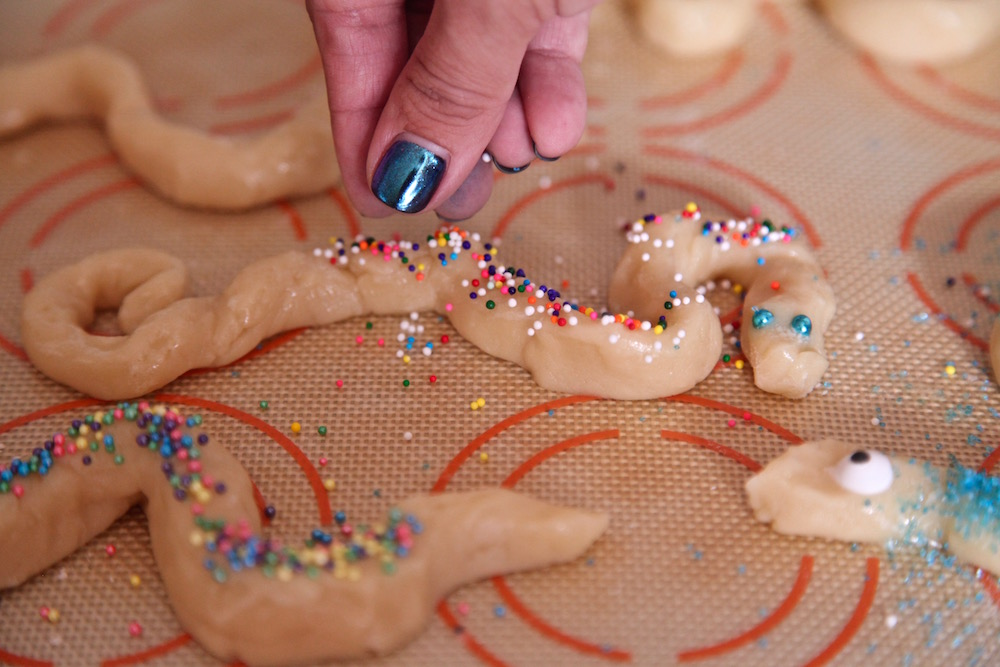 Decorate snake cookies with candy