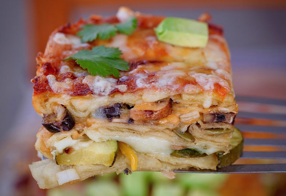 Vegetable Enchilada Casserole is a vegetarian dream come true. Meatless Mexican