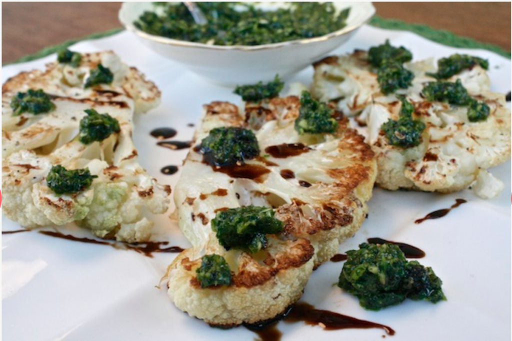 Roasted Cauliflower Steak in a Jalapeno Cilantro Chimichurri and balsamic vinegar