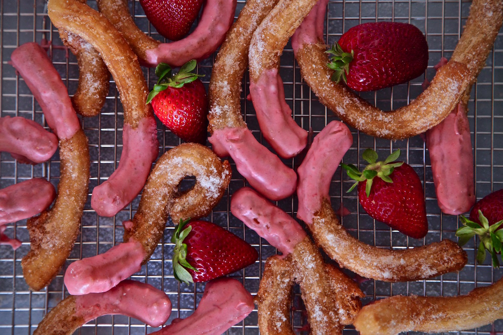 Strawberry churros all dusted in sugar