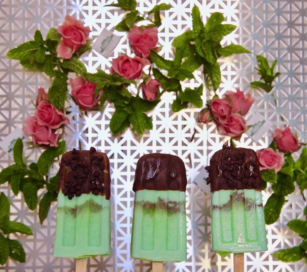 Mint and chip paletas made with TADIN tea and dipped in chocolate.