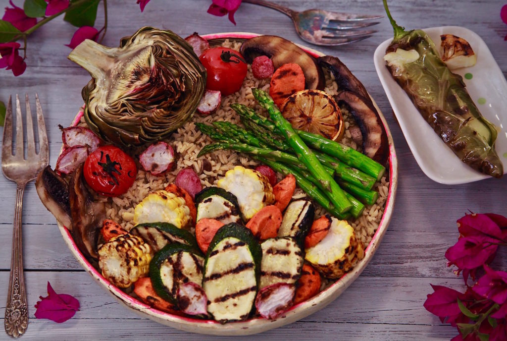 Vegetarian BBQ Bowl served with a cheese stuffed chile, and a side of grilled artichoke