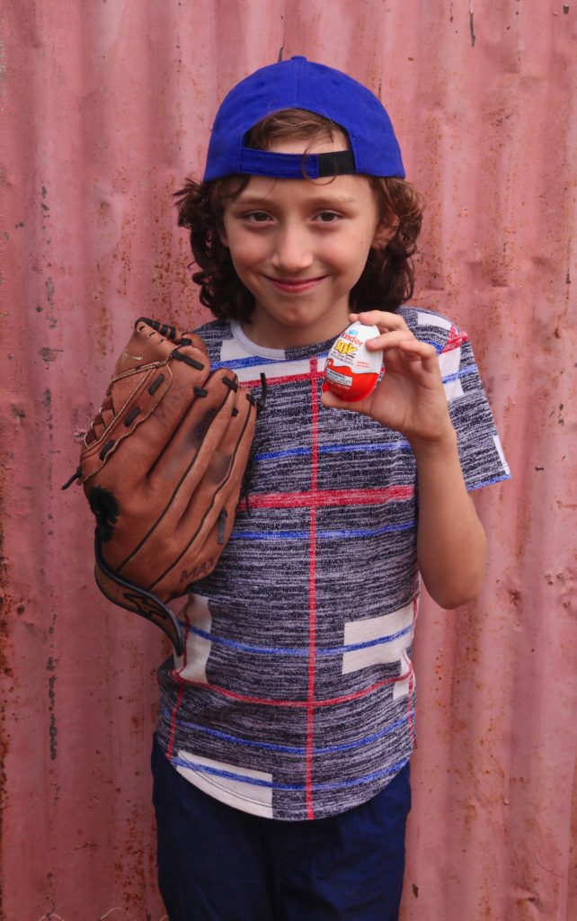 Max with his Kinder Joy after his baseball game.